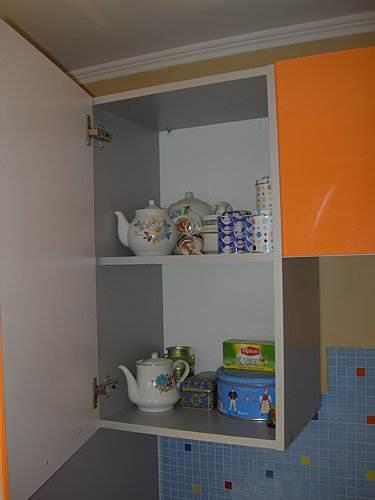 Оранжевая угловая кухня 7 5 кв м 15 фото