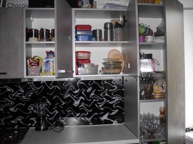 Дизайн угловой кухни, совмещенной с гостиной (11 фото)