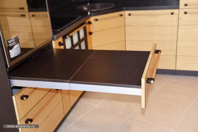 Выдвижная рабочая поверхность на кухне
